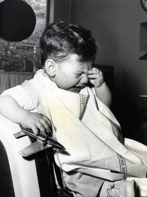 June, 3, 1961: Boy cries while seated in barber chair.
