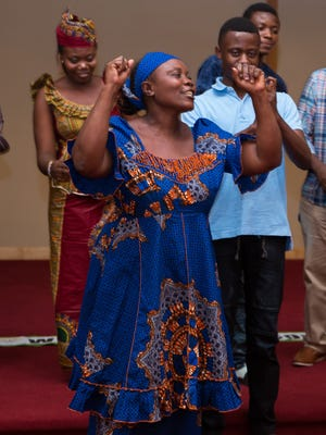 Antoinette and her family, from the Democratic Republic of Congo, lead an energizing prayer song in Swahili
