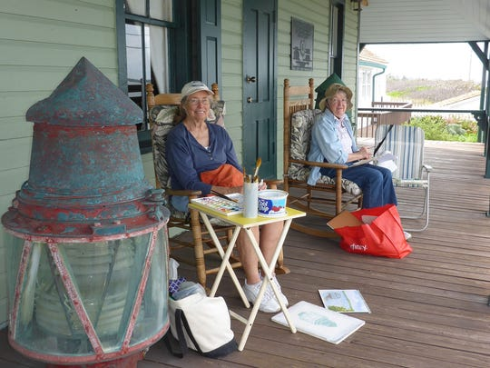 Peaches Sappington and Linda Okicki chat about their works they created at the House of Refuge Museum.