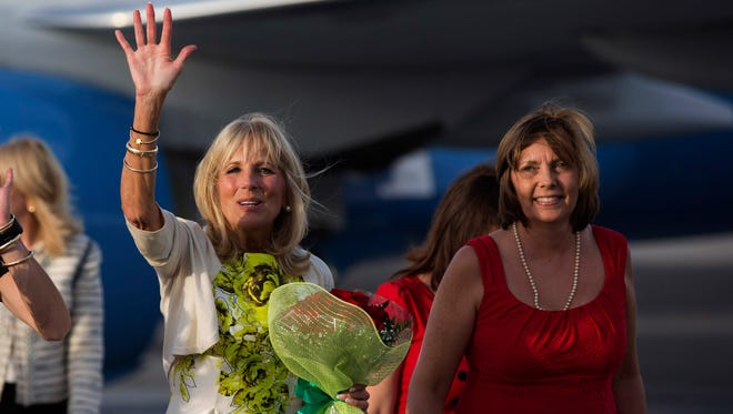 Dr. Jill Biden, wife of United States Vice President Joe Biden, arrives in Havana, Cuba. She is with the Director General of the U.S. division at Cuba's Foreign Ministry, Josefina Vidal, on the tarmac of Jose Marti International Airport.