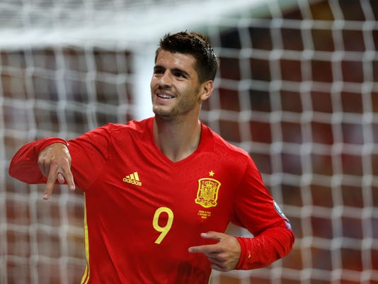FILE - In this Sept. 2, 2017 file photo, Spain's Alvaro Morata celebrates scoring his side's 3rd goal during the World Cup Group G qualifying soccer match between Spain and Italy at the Santiago Bernabeu stadium in Madrid, Spain. Spain enters the final stage of its World Cup preparations with coach Julen Lopetegui experimenting up front. Lopetegui has called up several different forwards since taking over the national squad and has plenty of options to choose from before announcing the final list for Russia in a few months. (AP Photo/Francisco Seco, File)