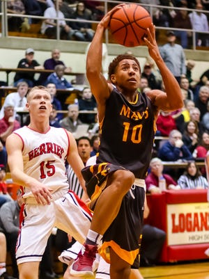 Robert Phinisee goes up for a layup as McCutcheon beat Logansport at the Berry Bowl in Logansport. Tuesday night.