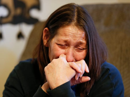 Karen Dunham, the mother of Cory Bruce, becomes emotional