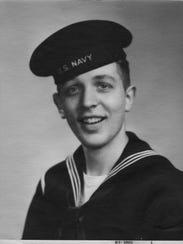 John Kelly was a radioman in the U.S. Navy.