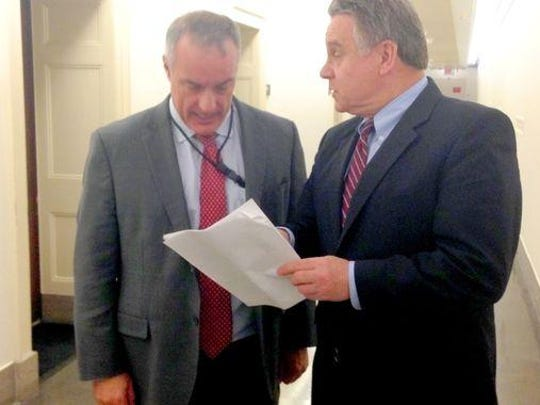 U.S. Rep. Chris Smith, R-N.J., right, speaks to Brad Kieserman, deputy associate administrator for insurance at the Federal Emergency Management Agency, during a meeting in March.