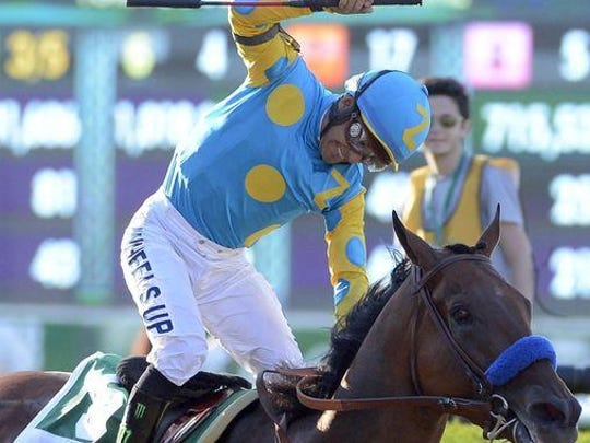 "Victor Espinoza reacts after riding American Pharoah to victory in Saturday's Belmont Stakes to complete the Triple Crown. His owner, Ahmed Zayat, indicated his next start will ""probably"" be in the Haskell Invitational at Monmouth Park on Aug. 2."