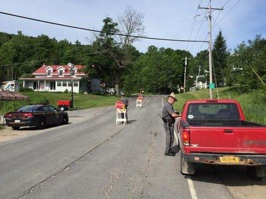 Police set up roadblocks in Malone.