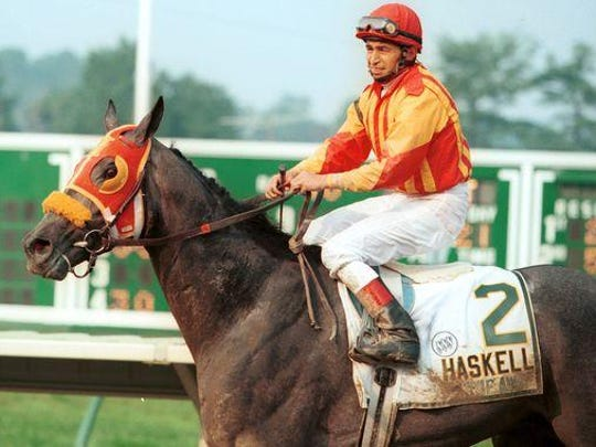 Skip Away returns to the winner's circle at Monmouth Park after winning the 1996 Haskell Invitational.