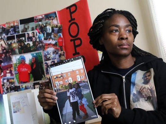 Lanita Brooks holds a picture of son Deshon Sellers, who was 17 when he was shot and killed on East 24th Street near Carter Street in Wilmington on Feb. 16.