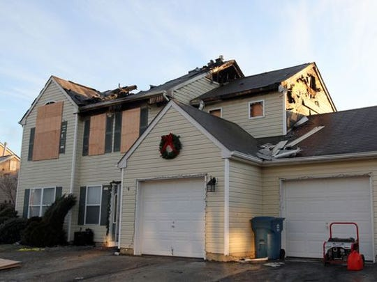 A home at 92 Cascades Avenue in Howell Township is shown Wednesday morning, December 31, after a late night fire Tuesday left the home heavily damaged.