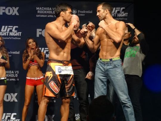 Lyoto Machida and Luke Rockhold square off after weigh-ins Friday at the Prudential Center. They meet in the main event Saturday of UFC Fight Night in Newark.