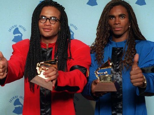 Rob Pilatus, left, and Fab Morvan of Milli Vanilli give the thumbs-up as they display their Grammys after being presented with the 1989 best new artist award in Los Angeles Feb. 21, 1990. They were later stripped of their award after being revealed as lip-synching poseurs. (Douglas C. Pizac, AP)