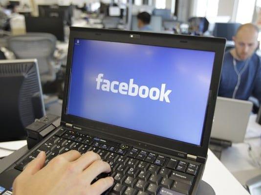 1391457373000-AP-Facebook-Beheadings.jpg