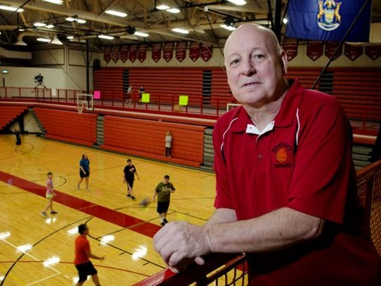 Al DeMott stands overlooking the Sandusky basketball court in the Mark S. Hund Gymnasium at Sandusky High School.