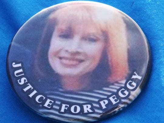"""Peggy Nadell is seen on a """"Justice for Peggy"""" button."""