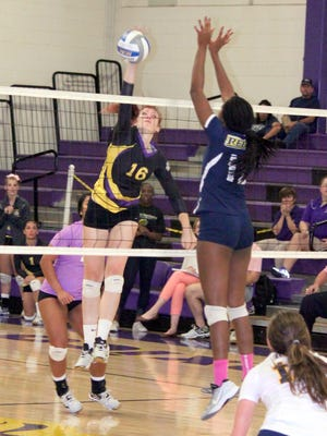 Western's Heather Verrill tallies a kill during action Saturday night against Regis. She posted eight on the night.