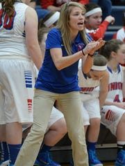 Union City coach Sarah Hines encourages her team during a basketball game against Hagerstown Tuesday, Jan. 27, 2015, in Union City.