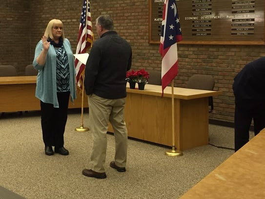 From left, Bucyrus Auditor Joyce Schifer takes the
