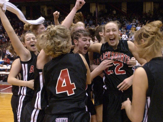 Members of the Waukesha South girls basketball team react after defeating Janesville Parker, 55-45, in the 2002 WIAA Division 1 state semifinal game at the UW Field House. Waukesha South went on to fall in the state final to Hudson, 65-46.
