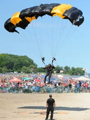 A Golden Knights member hits his mark as he lands on Bradford Beach during the 2017 Milwaukee Air & Water Show.