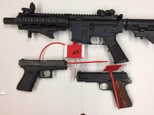 This short-barrelled AR-15 style rifle and handguns were seized from the home of suspected gang member Jorge Casillas-Flores on Monday.