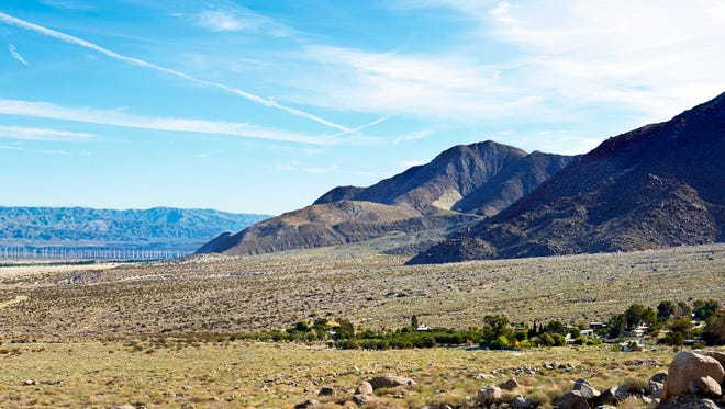 The vast desert and windmills act as a scenic backdrop for Snow Creek residents.
