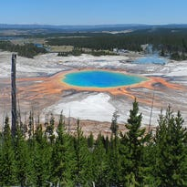 Yellowstone's Grand Prismatic hot spring is known for the bright multihued algae and bacteria coloring its edges, and the deep blue color at the center of its approximately 200-foot-wide pool.