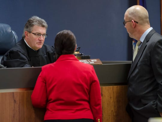 Judge Michael West listens to St. Clair County Assistant Prosecutor Amy Stover and defense lawyer Michael Boucher Tuesday, Jan. 10 during a conference at the trial of Judy Higley-Zuehlke in 31st Circuit Court in Port Huron.