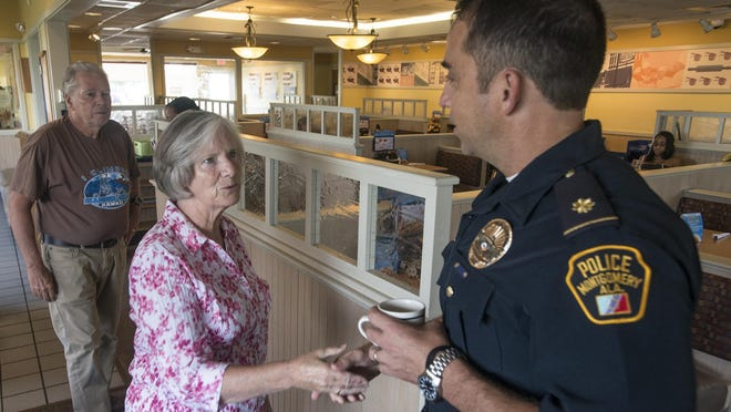 Maj. John Bowman of the Montgomery Police Department greets Jim and Frances Bickerton. Montgomery police had a chance to sit down with city residents over a cup of coffee Tuesday at the IHOP at 2950 East South Blvd.