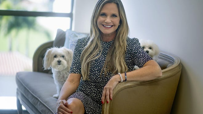 Robin Ganzert, president and chief executive officer of American Humane, with her dogs Daisy and Mr. Darcy, in the organization's new offices located at 251 Royal Palm Way in Palm Beach.