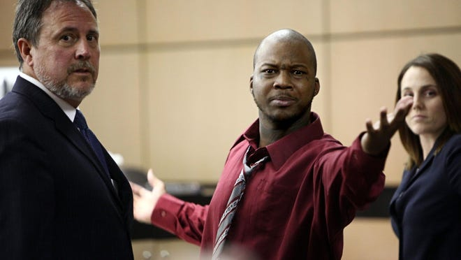 "Dominique Wright, seen here in a 2012 West Palm Beach courtroom as he faced charges of trying to kill James Howard, Jr., allegedly threatened Howard, saying ""I'm going to kill you"" and ""It's on."" Wright has been in prison since 2012, serving a 25-year term in the original 2008 shooting of Howard. At left was his attorney at the time Michael Hanrahan."