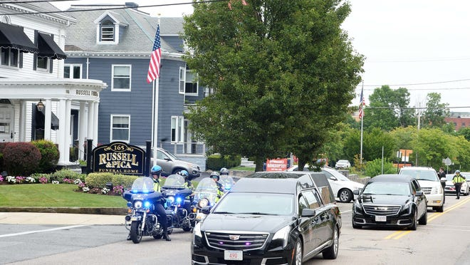 William L. Flynn, Jr., 84, of Brockton, funeral procession from Russel & Pica Funeral Homes to the Massachusetts National Cemetery in Bourne on Friday, July  17, 2020. William L. Flynn following graduation from Oliver Ames High School Class of 1953, joined the United State Marine Corps serving in the Korean War. Massachusetts police, and veterans groups were in the funeral procession.