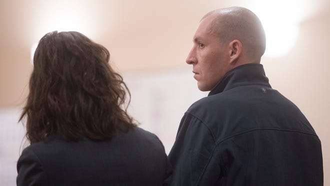 Joseph Giaquinto stands with his public defender, Heather Siegel, after sentencing at the Larimer County Justice Center on Thursday, January 4, 2018. Giaquinto was sentenced to wellness court and work release for charges of felony criminal mischief and a bias-motivated crime after he vandalized the Fort Collins Islamic Center in March 2017.
