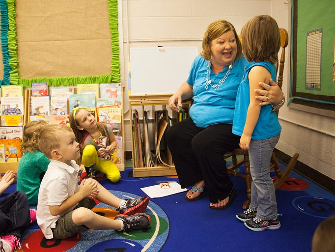 Kelley Cash teaches her kindergarten students a song to remember the days of the week on the first day of school at Verona Elementary School on Monday, Aug. 18, 2014. This year will be Cash's first year teaching at the elementary school.