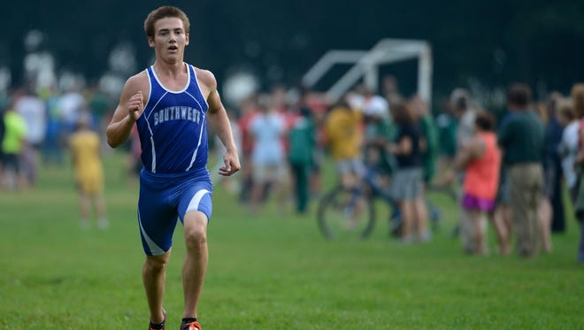 Green Bay Southwest's Alec Basten makes his way to a first-place finish with a time of 16:12.78 in the Green Bay City Meet race Thursday at Colburn Park in Green Bay.