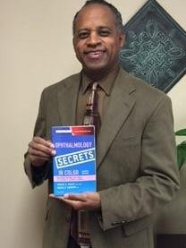 "Dr. Sydney L. Tyson of Eye Associates and SurgiCenter of Vineland holds a copy of the newly published book, ""Ophthalmology Secrets in Color,"" fourth edition, by Janice A. Gault and James F. Vander. Dr. Tyson wrote a chapter, ""Techniques of Cataract Surgery."""