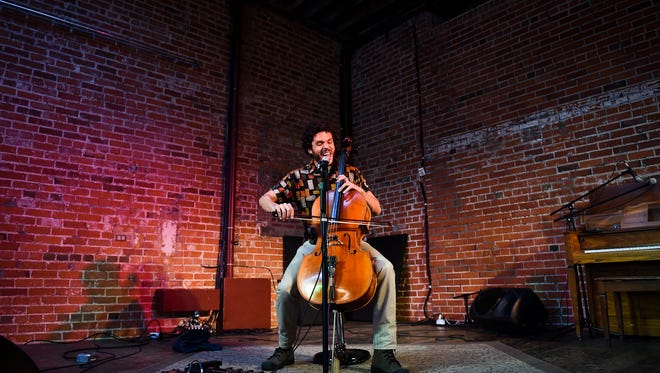 Ian Cooke performs at Everyday Joe's during the first day at FoCoMX, a festival for Northern Colorado artists Friday, April 24, 2015. The two day event showcases over 200 artists at over 20 venues in Fort Collins.