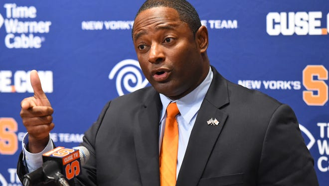 Syracuse coach Dino Babers reacts to a question during a press conference on Dec. 7