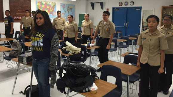 Socorro High School NJROTC students stand at attention on Oct. 16.