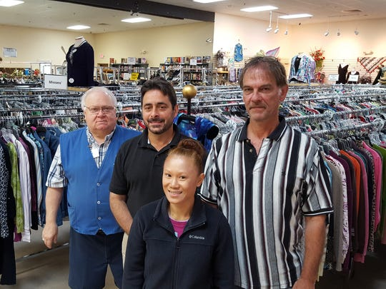 Management staff at St. Vincent de Paul's Wausau thrift store pose for a photo on June 15, 2016, including Assistant Manager Bob Schmit (left), General Manager Orlando Alfonso, Store Manager Toni Sananikone and Warehouse Manager Scott Whitcraft.