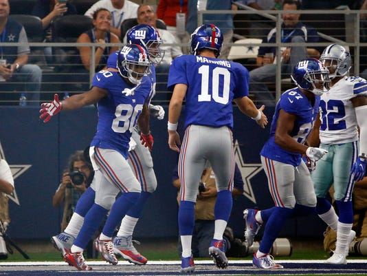 New York Giants wide receiver Victor Cruz (80) celebrates his touchdown catch with quarterback Eli Manning (10) in the second half of an NFL football game against the Dallas Cowboys, Sunday Sept. 11, 2016, in Arlington, Texas. (AP Photo/Ron Jenkins)