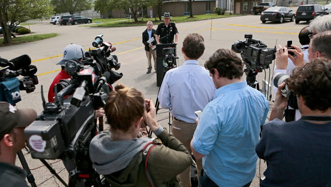 Members of the media at a news conference on Wednesday in Waverly, Ohio, that was conducted by Ohio Attorney General Mike DeWine and Pike County Sheriff Charles Reader.
