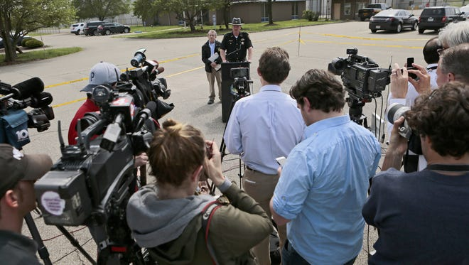 Ohio Attorney General Mike DeWine and Pike County Sheriff Charles Reader deliver an update on the Rhoden murders at the makeshift command center in Waverly on April 27.