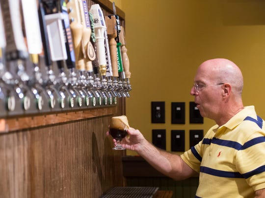 Casual Pint Farragut owner Pat O'Brien pours a beer during the inaugural Casual Mondays Blues Jam.