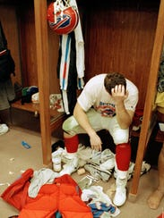 Mark Pike of the Buffalo Bills grieves after his team's