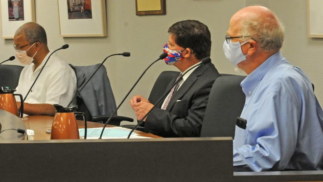 City of Salina Commissioners Trent Davis, Karl Ryan and Rod Franz discuss  Project Gemini and Project Rise during the special meeting Thursday at the City-County Building.