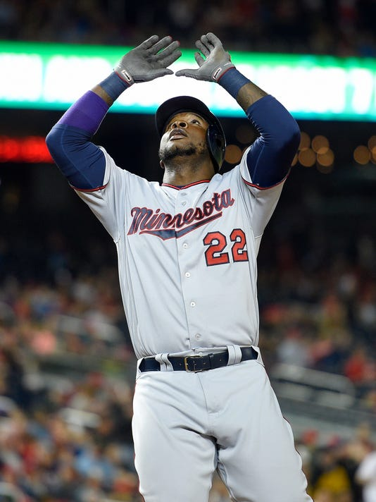 Minnesota Twins' Miguel Sano celebrates his home run during the eighth inning of the Twins' baseball game against the Washington Nationals, Friday, April 22, 2016, in Washington. The Nationals won 8-4. (AP Photo/Nick Wass)
