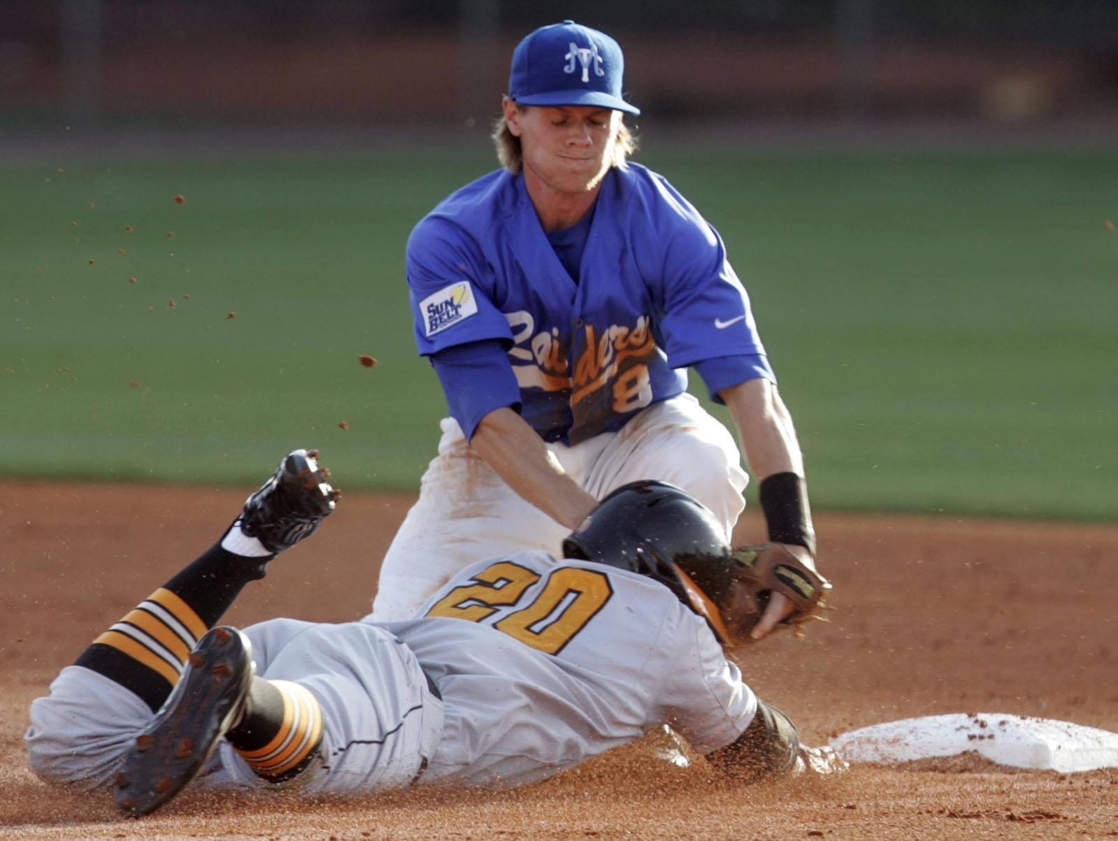 MTSU second baseman Dathan Prewett tags out Tennessee's Christin Stewart during a recent game. Stewart was drafted by Detroit with the 34th pick Monday