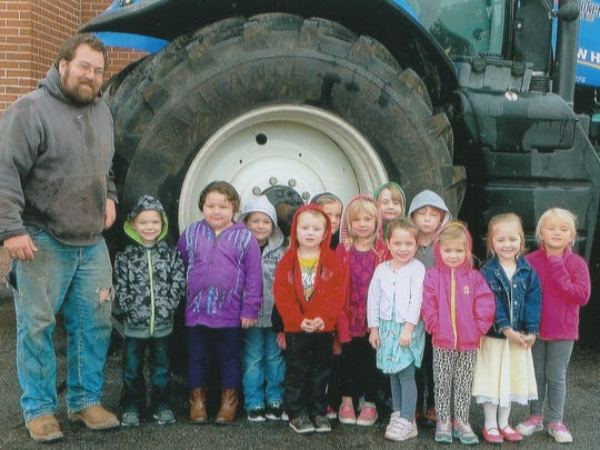 St. John Lutheran School 4-year-old kindergarten students had a chance to check out farmer Ryan Prahl's tractor.