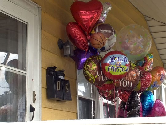 Balloons filled the porch of the Long Branch home where Joan Colbert and Veronica Roach were found dead in 2014.